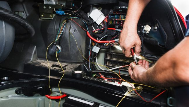 one of our team wiring a customers car